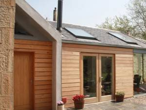 Architects Glasgow extension design with natural slate roof and siberian larch cladding